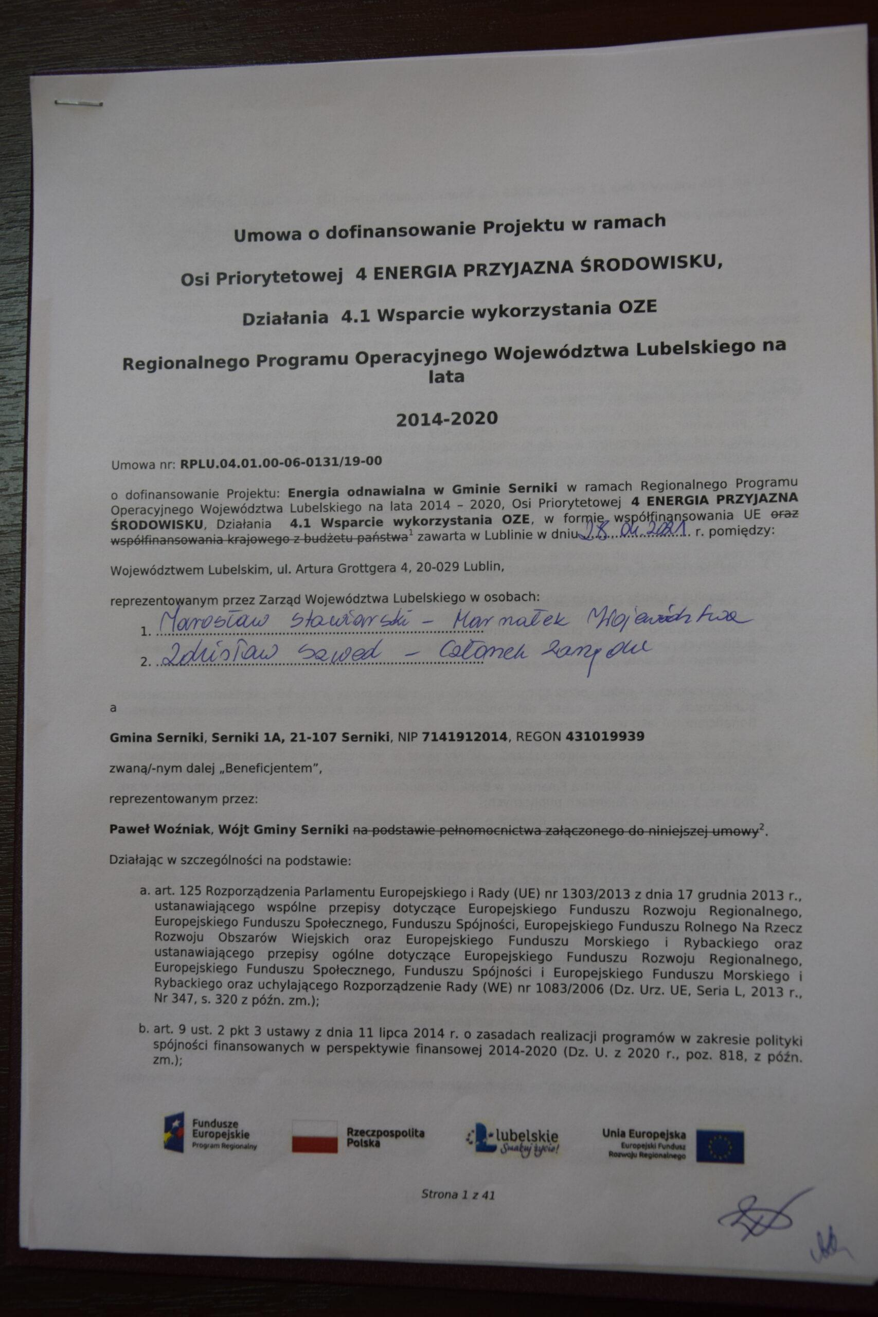 Zdjęcie przedstawia pierwszą stronę umowy o dofinansowanie projektu w ramach osi prorytetowej 4 Energia przyjazna środowisku, Działania 4.1 Wsparcie wykorzystania OZE Regionalnego Programu Operacyjnego Województwa Lubelskiego na lata 2014-2020